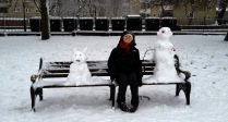 sitting on the bench with new snowy friends...