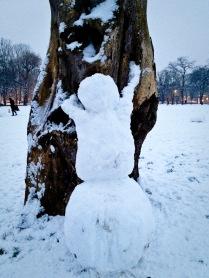 the climbing tree-hugging snowman